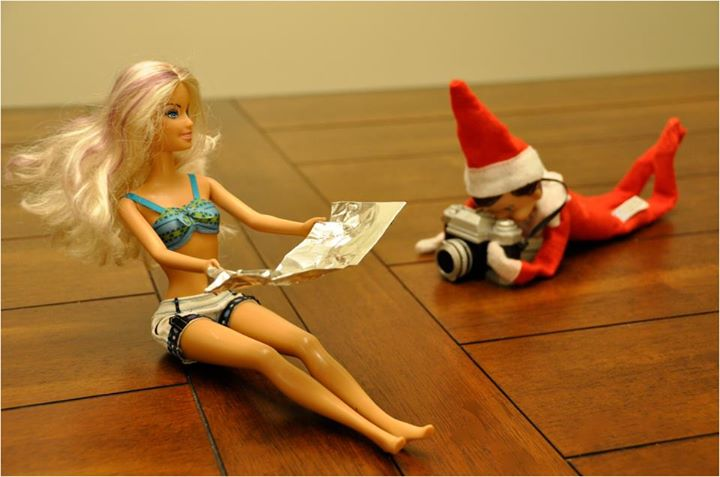 elfie snapping pic of barbie